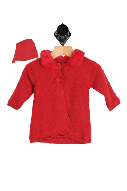 Front shows bright red long sleeve winter coat featuring a knitted outsite with top 2 button closure, detachable faux fur collar & fully lined fur-like inside! Jacket comes with matching knitted bonnet with same fur-like lining.