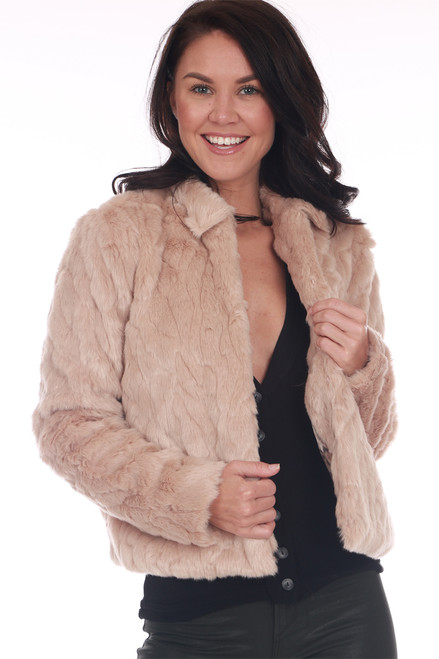 Oatmeal colored faux fur waist length coat with small collar, hook and eye closure at top with side pockets.