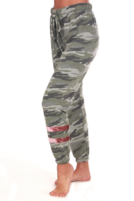 Camo olive jogger pants has an elastic waistband with drawstring, mid-rise and tapered skinny legs with a pink velvet stripe detailing at bottom of left leg.