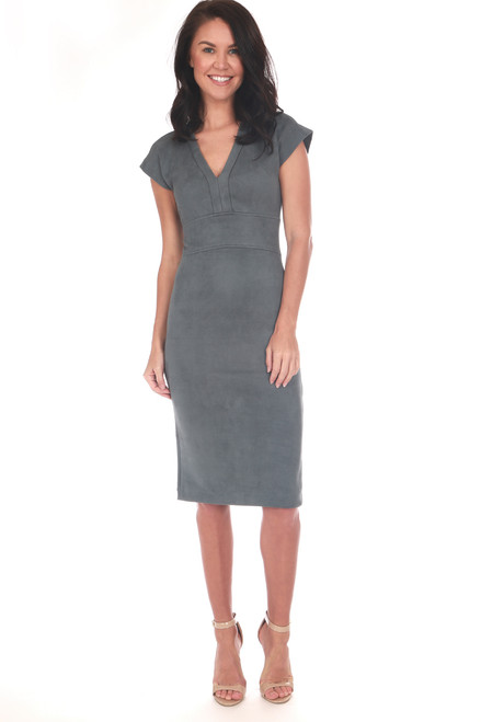 Grey-blue faux suede short sleeved dress with a deep V neckline and fitted body, midi length and super stretchy material which falls below the knee.