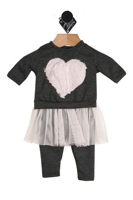 Two piece set for baby.  Black long sleeve top with a pink faux fur heart at front & button closure at back.  Matching black leggings with attached pink tulle tutu.