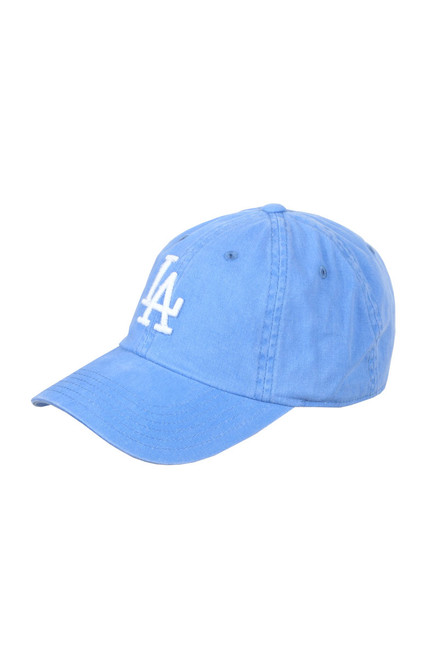 Front shows bright baby blue New Raglan LA Dodgers Baseball Cap with unstructured slouch, pigment washed for a soft faded look, distressed screen-print under-visor, lofted cotton yarn embroidered logo, adjustable self-fabric back strap.