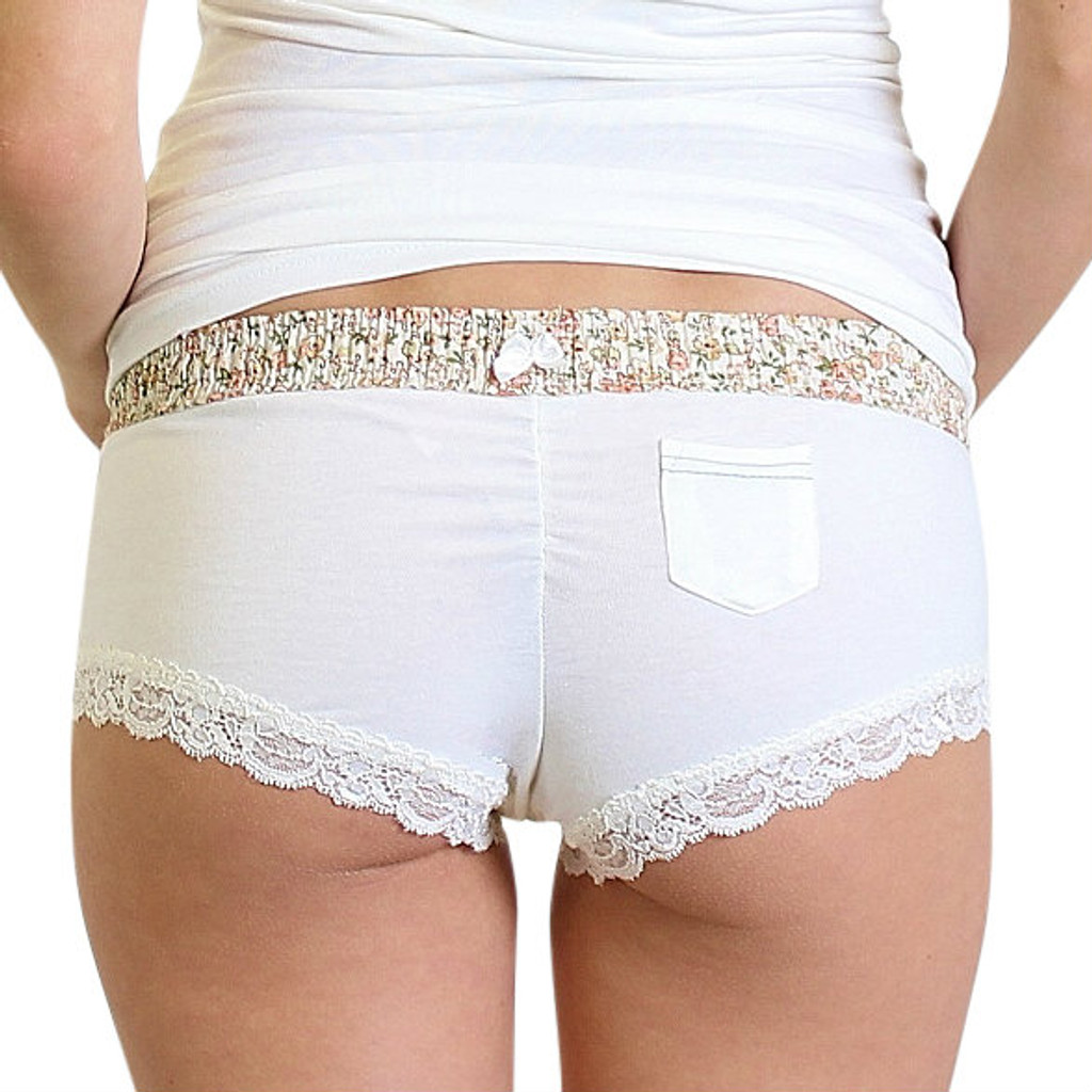 Ivory boy shorts with floral waistband and pocket