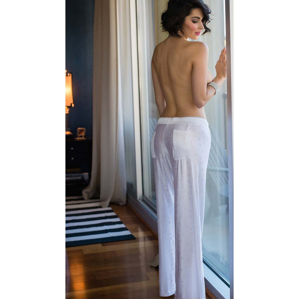 White lounge pants with soft, slinky eyelet fabric.