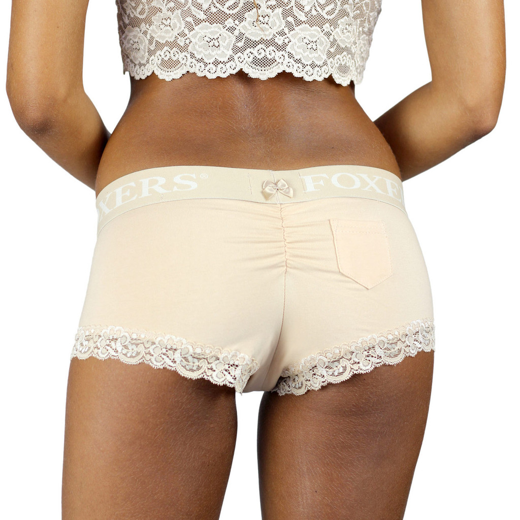 The back of our Nude Boyshorts Panties with Foxers Logo Waistband is detailed with a small nude bow and a slight ruching that enhances your butts cuteness!