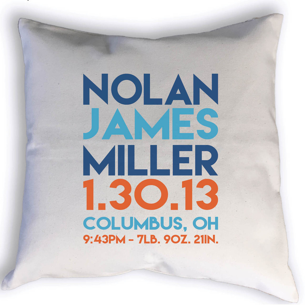 Custom Birth Stats throw pillow with name, birth date, city, state, time, weight & length. Image shows stats printed in blues and orange.