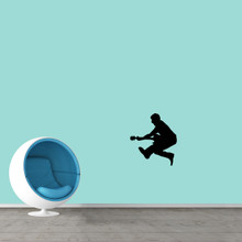 """Jumping Guitar Player Wall Decal 16"""" wide x 18"""" tall Sample Image"""