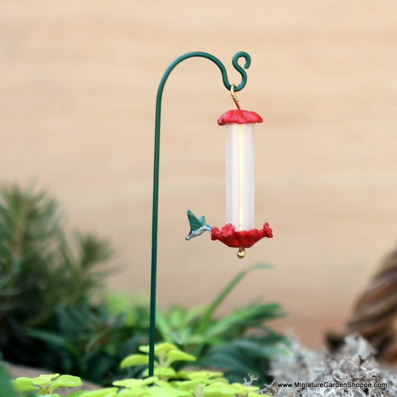 pros feeder answered humming at reader b the feeders by birds hummingbirds bird about birding questions melody attracting wright photo hummingbird