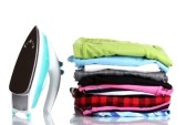 12436237-pile-of-colorful-clothes-and-electric-iron-isolated-on-white.jpg