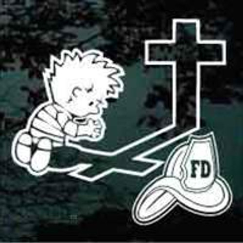 Boy Firefighter Praying at the Cross