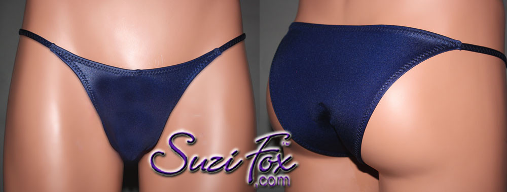 Mens Smooth Front, Skinny Strap, Rio Bikini - shown in Navy Blue Wetlook Lycra Spandex, custom made by Suzi Fox. • Available in black, white, red, turquoise, navy blue, royal blue, hot pink, lime green, green, yellow, steel gray, neon orange Wet Look or any fabric on this site. • Standard front height is 6 inches (15.24 cm). • Available in 4, 5, 6, 7, 8, 9, and 10 inch front heights. • Wear it as swimwear OR underwear! • Made in the U.S.A.