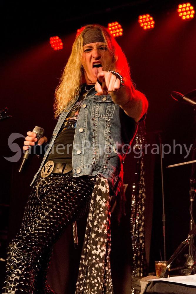 Michael Diamond of the band Metal Shop Dallas in his Suzi Fox black 3D vinyl pants. Photo by Chris Sanders. R.A.W.K. ON!!!!