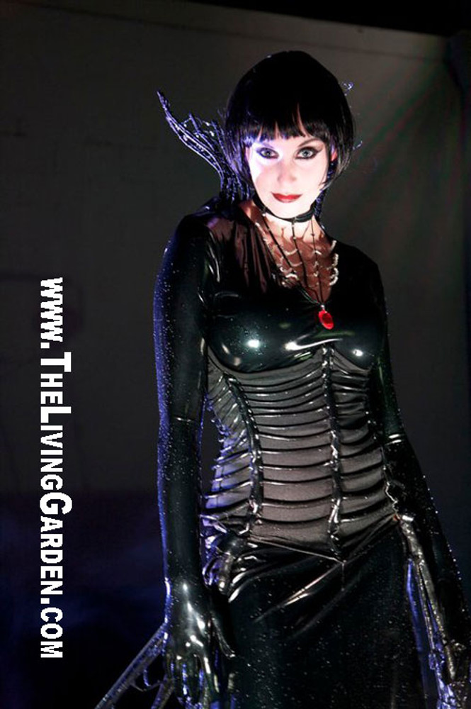 The base dress for this costume was custom made by Suzi Fox for The Living Garden®'s Black Widow show. Corset and accessories by The Living Garden®. Yes, that's water! See their site at www.TheLivingGarden.com