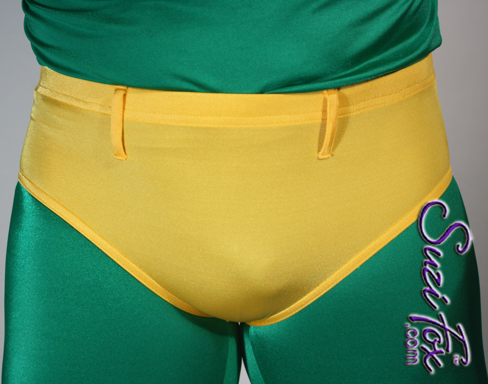 Men's Smooth Front, Brief Bikini, custom made by Suzi Fox shown in Athletic Gold Milliskin Tricot spandex shown with optional belt loops. Available in black, white, red, navy blue, royal blue, sky blue, turquoise, green, neon green, hunter green, neon pink, neon orange, athletic gold, yellow, steel gray, purple. 1 inch elastic at the waist. Optional belt loops and rear patch pockets available. Made in the U.S.A.