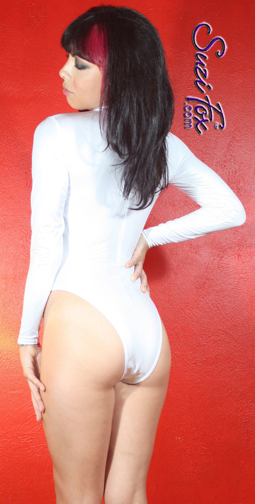 Custom Leotard by Suzi Fox shown in White Wet Look Lycra Spandex.  You can order this Leotard in almost any fabric on this site.  • Available in black, red, white, turquoise, navy blue, hot pink, lime green, green, yellow, royal blue, steel gray, neon orange. This is a 4-way stretch fabric with a medium shine. Shown with French Legs (Rio rear). • Your choice of rears - French legs (Rio), Cheeky, Full, or Thong. • Made in the U.S.A.