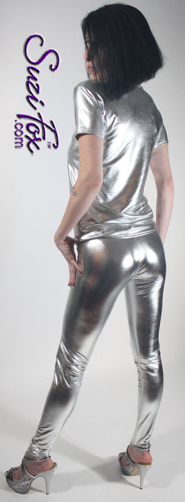 Womens Leggings shown in Silver Metallic Foil Spandex, custom made by Suzi Fox. Super Low rise shown. You can order this in almost any fabric on this site.  • Custom made to your measurements! • Available in gold, silver, copper, royal blue, purple, turquoise, red, green, fuchsia, gun metal, black faux leather/rubber coated spandex. This is a 4-way stretch fabric with a brilliant shine. • 1 inch elastic at the waist. • Optional 1 or 2-slider crotch zipper. • Optional ankle zippers • Optional rear patch pockets • Optional belt loops • Made in the U.S.A.