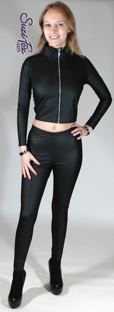 Womens Leggings shown in Black Matte (no shine) vinyl/PVC, custom made by Suzi Fox.  You can order this in almost any fabric on this site.  • Custom made to your measurements! • Available in black, red, white, light pink, neon pink, fuchsia, purple, royal blue, navy blue, turquoise, black matte (no shine), white matte (no shine) stretch vinyl coated spandex. • 1 inch elastic at the waist. • Optional 1 or 2-slider crotch zipper. • Optional ankle zippers • Optional rear patch pockets • Optional belt loops • Made in the U.S.A.