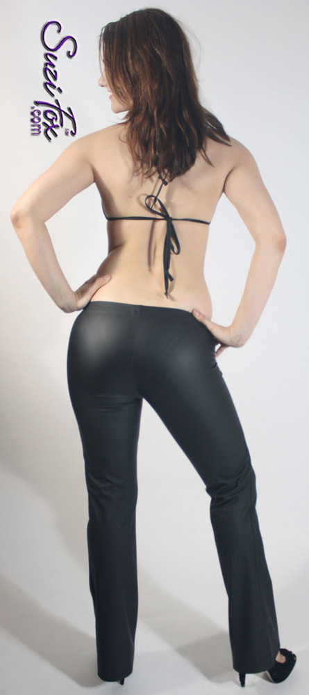 Womens Boot Cut Pants shown in Black Matte (no shine) vinyl/PVC, custom made by Suzi Fox.  You can order this in almost any fabric on this site.  • Custom made to your measurements! • Available in black, red, white, light pink, neon pink, fuchsia, purple, royal blue, navy blue, turquoise, black matte (no shine), white matte (no shine) stretch vinyl coated spandex. • 1 inch elastic at the waist. • Optional 1 or 2-slider crotch zipper. • Optional ankle zippers • Optional rear patch pockets • Optional belt loops • Made in the U.S.A.