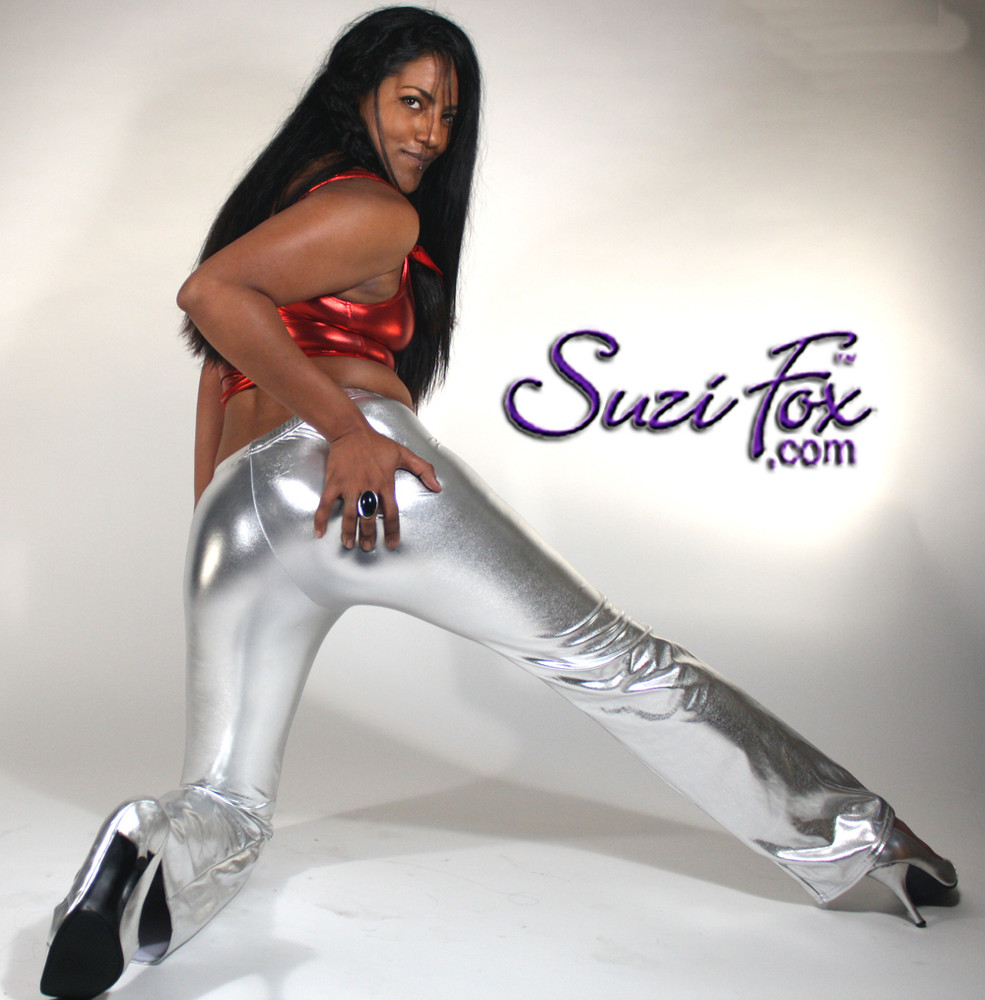 Womens Boot Cut Pants shown in Silver Metallic Foil Spandex, custom made by Suzi Fox. You can order this in almost any fabric on this site.  • Custom made to your measurements! • Available in gold, silver, copper, royal blue, purple, turquoise, red, green, fuchsia, gun metal, black faux leather/rubber coated spandex. This is a 4-way stretch fabric with a brilliant shine. • 1 inch elastic at the waist. • Optional 1 or 2-slider crotch zipper. • Optional ankle zippers • Optional rear patch pockets • Optional belt loops • Made in the U.S.A.