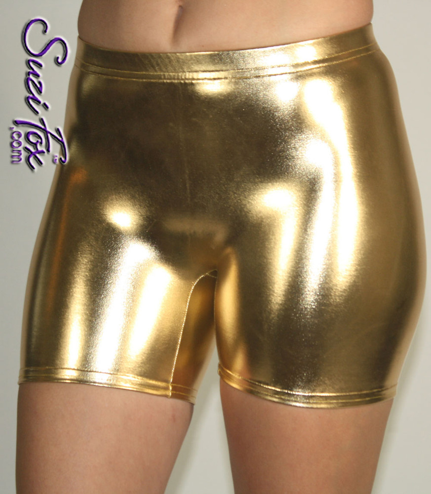 Women's Smooth Front Shorts shown in Gold Metallic foil coated Spandex, custom made by Suzi Fox. Custom made to your measurements! Available in gold, silver, copper, gunmetal, turquoise, Royal blue, red, green, purple, fuchsia, black faux leather/rubber, and any other fabric on this site. • 1 inch no-roll elastic in the waist. • Choose your inseam! • Optional rear patch pockets. • Optional belt loops. Made in the U.S.A.