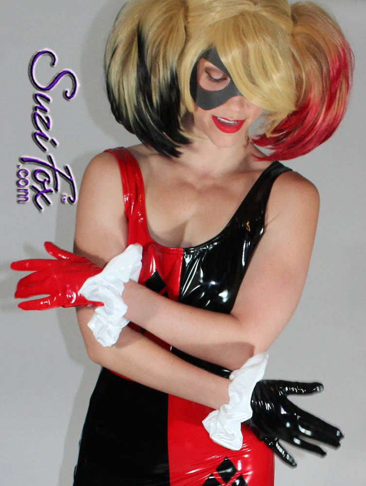 Harley Quinn Gloves shown in Black & Red Gloss Vinyl/PVC with White Wrist Ruffles by Suzi Fox. Give us your bicep and wrist measurements for a perfect fit! Popular fabrics are: red & black vinyl/PVC, red & black metallic foil, red & black wet look lycra Spandex. Made in the U.S.A.