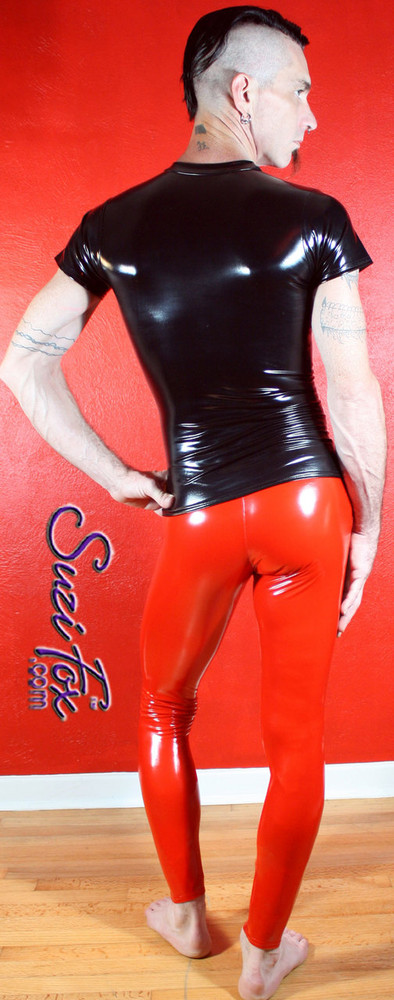 Mens Hiphugger Leggings shown in Gloss Red Vinyl/PVC Spandex, custom made by Suzi Fox. Custom made to your measurements! • Available in black, white, red, navy blue, royal blue, turquoise, purple, Neon Pink, fuchsia, light pink, matte black (no shine), matte white (no shine), black 3D Prism, red 3D Prism, Turquoise 3D Prism, Baby Blue 3D Prism, Hot Pink 3D Prism Vinyl and any fabric on this site. • 1 inch no-roll elastic at the waist. • Optional 1 or 2-slider crotch zipper. • Choose your ankle size - tight ankles, jean cut, boot cut, or bellbottom. • Optional ankle zippers. • Optional belt loops. • Optional rear patch pockets. Made in the U.S.A.