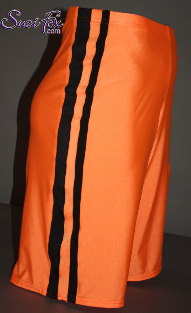 Mens Basketball or Board shorts shown in Neon Orange and Black Milliskin Tricot Spandex, custom made by Suzi Fox. • Available in black, white, red, royal blue, sky blue, turquoise, purple, green, neon green, hunter green, neon pink, neon orange, athletic gold, lemon yellow, steel gray Miilliskin Tricot spandex and any fabric on this site. • 1 inch no-roll elastic at the waist. • Optional belt loops. • Optional rear patch pockets. • Optional drawstring. • Made in the U.S.A.