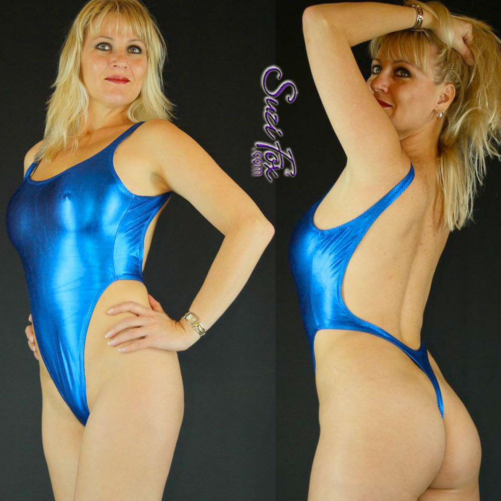 Womens One Piece T-back Thong Swim Suit shown in Royal Blue Metallic foil Spandex, custom made by Suzi Fox. • Custom made to your measurements. • The high leg hole, low back and t-back thong rear create a stunning and sexy suit. • Available in gold, silver, copper, gunmetal, turquoise, Royal blue, red, green, purple, fuchsia, black faux leather/rubber Metallic Foil, and any fabric on this site. • Made in the U.S.A.