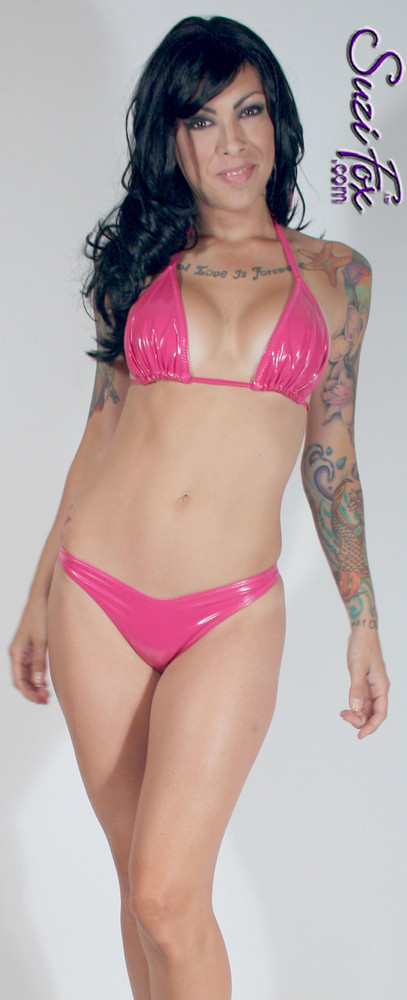 Adjustable Triangle String Bikini Top shown in gloss Neon Pink Vinyl/PVC Spandex, custom made by Suzi Fox. • Adjustable! Make it thinner or wider! • Available in black, white, red, navy blue, royal blue, turquoise, purple, Neon Pink, fuchsia, light pink, matte black (no shine), matte white (no shine), black 3D Prism, red 3D Prism, Turquoise 3D Prism, Baby Blue 3D Prism, Hot Pink 3D Prism Vinyl/PVC, and any fabric on this site. • Bottom sold separately. (B8 Brazilian bikini shown) • Made in the U.S.A.