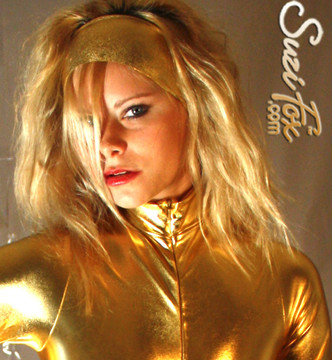 """Custom Catsuit by Suzi Fox shown in Gold metallic foil coated Nylon Spandex.  You can order this Catsuit in almost any fabric on this site.  • Available in gold, silver, copper, royal blue, purple, turquoise, red, green, fuchsia, gun metal, black faux leather/rubber Metallic foil coated spandex. • Your choice of front or back zipper (front zipper shown). • Optional 1 or 2-slider crotch zipper, and """"Selene"""" from Underworld TS Brass zipper, or aluminum circular slider zipper like Catwoman comic characters. • Optional wrist zippers • Optional ankle zippers • Optional finger loops • Optional rear patch pockets • Made in the U.S.A."""