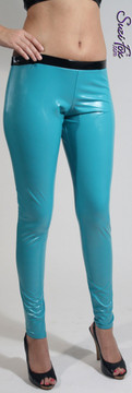"""Womens Leggings shown in Turquoise Vinyl/PVC, Featured in the play RENT, custom made by Suzi Fox.  Shown with black waistband as seen in the play """"RENT."""" You can order this in almost any fabric on this site.  • Custom made to your measurements! • Available in gloss black, white, red, navy blue, royal blue, turquoise, purple, neon pink, fuchsia, light pink, matte (no shine) black, matte (no shine) white. 4 way stretch, great alternative to latex! • 1 inch elastic at the waist. • Optional 1 or 2-slider crotch zipper. • Optional ankle zippers • Optional rear patch pockets • Optional belt loops • Made in the U.S.A."""