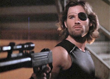 Escape From New York (1981) is a cult-classic action film featuring the dream team of John Carpenter and Kurt Russell. The story is one of the classics: a rescue mission. The President's plane has crashed in the badlands, and so Police Commissioner Bob Hauk (Lee Van Cleef) is forced to recruit the most Badass criminal available to go in after him. That man is Snake Plissken.