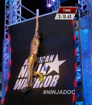 Noah Kauffman on American Ninja Warrior wearing Suzi Fox gold shirt and pants! Mens pants shown in Gold Metallic Foil coated Spandex, custom made by Suzi Fox. Custom made to your measurements! • Available in gold, silver, copper, gunmetal, turquoise, Royal blue, red, green, purple, fuchsia, black faux leather/rubber Metallic Foil and any fabric on this site. • 1 inch no-roll elastic at the waist. • Optional 1 or 2-slider crotch zipper. • Choose your ankle size - tight ankles, jean cut, boot cut, or bellbottom. • Optional ankle zippers. • Optional belt loops. • Optional rear patch pockets. Made in the U.S.A.