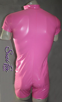 Mens Custom Romper shown in Neon Pink Vinyl/PVC Spandex, custom made by Suzi Fox.  • Choose any fabric on this site, including vinyl/PVC, metallic foil, metallic mystique, wetlook lycra Spandex, Milliskin Tricot Spandex. • Optional Custom Sizing. • Plus size available. • Optional 1 or 2-slider crotch zipper. • Optional wrist zippers. • Worldwide shipping. • Made in the U.S.A.