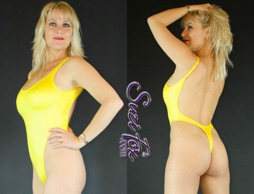 Womens One Piece, T-Back Thong Swimsuit, shown in Yellow Wetlook Lycra Spandex, custom made by Suzi Fox. • Custom made to your measurements. • The high leg hole, low back and t-back thong rear create a stunning and sexy suit. • Available in black, white, red, turquoise, navy blue, royal blue, hot pink, lime green, green, yellow, steel gray, neon orange Wet Look, and any fabric on this site. • Made in the U.S.A.