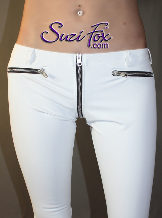 Womens 5 Zipper Leggings with crotch zipper, faux zippered pockets, and ankle zippers shown in Matte (no shine) White Vinyl/PVC, by Suzi Fox.  • 1 inch no-roll elastic at the waist. • Choice of zippers. • Choose your ankle size - tight ankles, jean cut, boot cut, or bellbottom. • Optional rear patch pockets. • Optional belt loops. • You can choose any fabric on this site, including vinyl/PVC, Metallic Foil, Metallic Mystique, Wetlook Lycra Spandex, Milliskin Tricot Spandex.