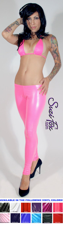 Womens Leggings shown in Neon Pink Gloss vinyl/PVC, custom made by Suzi Fox.  Low rise shown. You can order this in almost any fabric on this site.  • Custom made to your measurements! • Available in black, red, white, light pink, neon pink, fuchsia, purple, royal blue, navy blue, turquoise, black matte (no shine), white matte (no shine) stretch vinyl coated spandex. • 1 inch elastic at the waist. • Optional 1 or 2-slider crotch zipper. • Optional ankle zippers • Optional rear patch pockets • Optional belt loops • Made in the U.S.A.