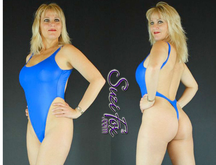 Womens One Piece T-back Thong Swim Suit shown in Royal Blue Wet Look lycra Spandex, custom made by Suzi Fox. • Custom made to your measurements. • The high leg hole, low back and t-back thong rear create a stunning and sexy suit. • Available in black, white, red, turquoise, navy blue, royal blue, hot pink, lime green, green, yellow, steel gray, neon orange Wet Look, and any fabric on this site. • Made in the U.S.A.
