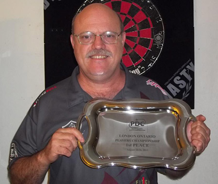 Dart Brokers Pro Player Larry Butler with London PDC First Place Trophy