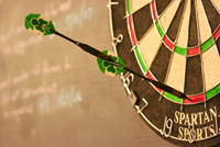 A Robin Hood: one dart sticking into the flight of another