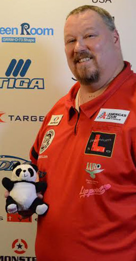 Pro dart player Scotty Kirchner with a dart trophy