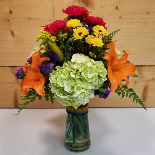 Rainbow Blooms (SCF17SP03) by Savilles Country Florist.  Flower and Plant delivery to Orchard Park, NY and the surrounding area including same day delivery to Hamburg, West Seneca, East Aurora, Blasdell and Buffalo NY