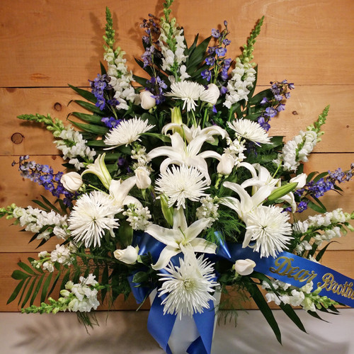 Blue & White Sympathy Arrangement  by Savilles Country Florist. Flower delivery to Orchard Park, Hamburg, West Seneca, East Aurora, Buffalo, NY and surrounding suburbs.