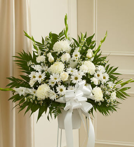 Heartfelt Sympathies White Arrangement  by Savilles Country Florist. Flower delivery to Orchard Park, Hamburg, West Seneca, East Aurora, Buffalo, NY and surrounding suburbs.