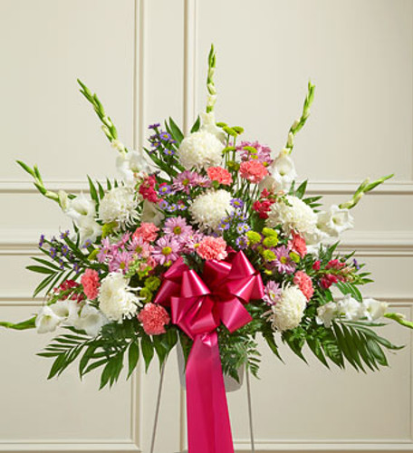 Heartfelt Sympathies Pastel Arrangement by Savilles Country Florist. Flower delivery to Orchard Park, Hamburg, West Seneca, East Aurora, Buffalo, NY and surrounding suburbs.