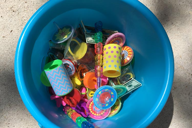 Blue bucket with inexpensive carnival prizes