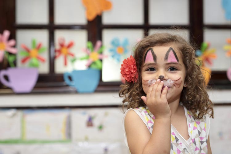 face-painted-girl-inside-school-at-carnival.jpg