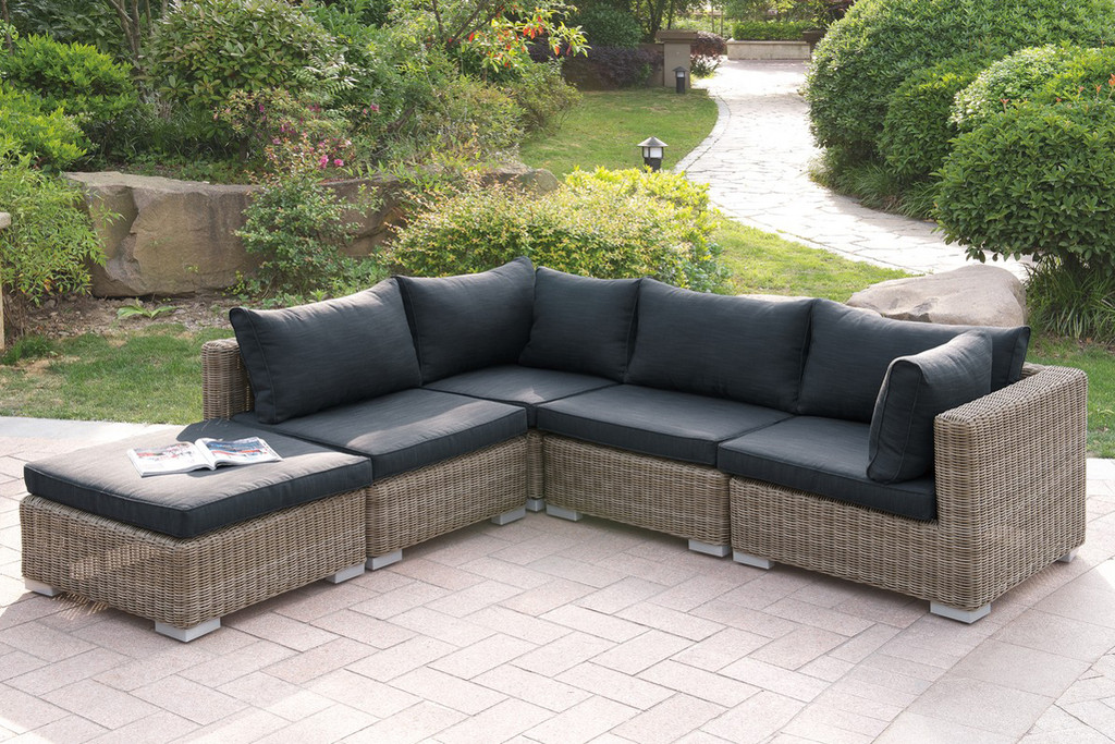 VERSATILE 5PC OUTDOOR PATIO SOFA SETWITH OTTOMAN IN TAN RESIN WICKER FINISH AND BLACK SEAT CUSHIONS