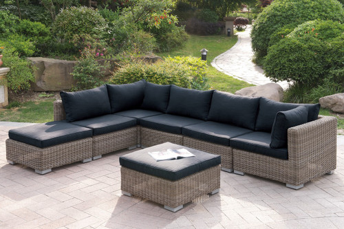7PC OUTDOOR PATIO SOFA SET IN TAN RESIN WICKER FINISH WITH OTTOMAN AND BLACK SEAT CUSHIONS