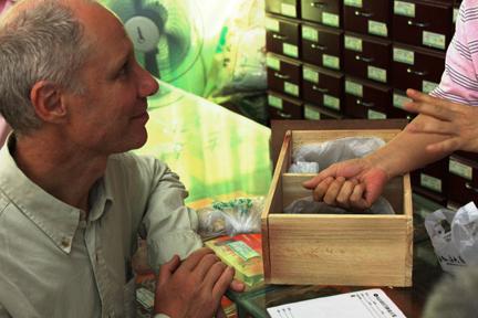 Heiner Fruehauf assessing herb quality